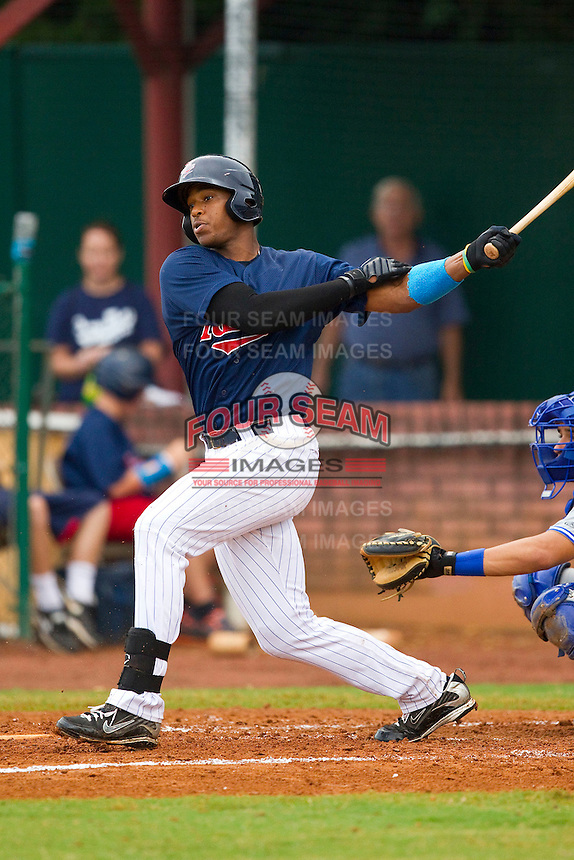 Adam Walker #45 of the Elizabethton Twins follows through on his swing against the Bluefield Blue Jays at Joe O'Brien Field on July 14, 2012 in Elizabethton, Tennessee.  The Twins defeated the Blue Jays 4-0.  (Brian Westerholt/Four Seam Images)