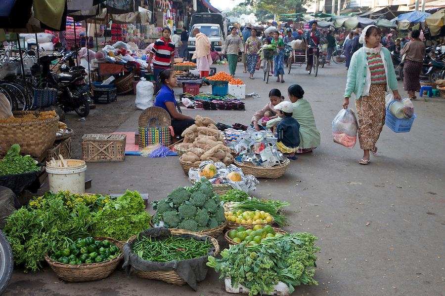 Myanmar, Burma.  Mandalay Street Scene.  Vegetables for sale on the street.