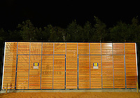 July 22, 2012..View of a wooden wall built to conceal an electrical transformer displays a poem by Lemn Sissay at the Olympics Park in London, Great Britain.