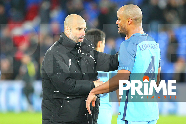Manchester City manager Pep Guardiola and Vincent Kompany celebrate winning during the FA Cup fourth round match between Crystal Palace and Manchester City at Selhurst Park, London, England on 28 January 2017. Photo by PRiME Media Images / Steve McCarthy.