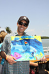 Tom Pelphrey holds one of his paintings at the Cruisin' & Schmoozin' with the Stars on the Marco Island Princess sightseeing tour of beautiful Marco Island, watching the dolphins, autographs, photos, auctions & a buffet luncheon on May 15 Marco Island, Florida - SWFL Soapfest Charity Weekend May 14 & !5, 2011 benefitting several children's charities including the Eimerman Center providing educational & outreach services for children for autism. see www.autismspeaks.org. (Photo by Sue Coflin/Max Photos)