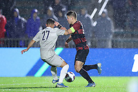 CARY, NC - DECEMBER 13: Logan Panchot #22 of Stanford University is defended by Zach Riviere #27 of Georgetown University during a game between Stanford and Georgetown at Sahlen's Stadium at WakeMed Soccer Park on December 13, 2019 in Cary, North Carolina.