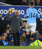 6th February 2019, Goodison Park, Liverpool, England; EPL Premier League Football, Everton versus Manchester City; Manchester City manager Pep Guardiola catches the ball on the touchline