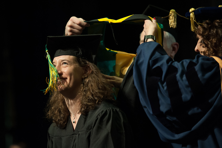 Carrie Cecil, ANTH MA, is hooded during the UAA Spring 2018 Graduate Degree Hooding Ceremony.