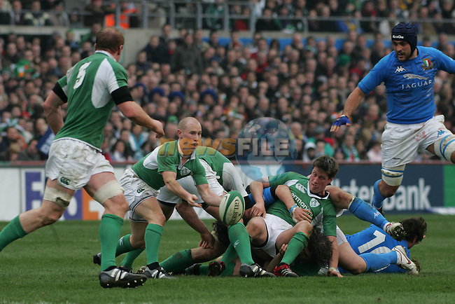 Dublin Ireland, the Opening match of the RBS Six nations between Ireland and Italy,  Ireland no 9 Peter Stringer (2L) clearing the ball from the tackle during the match in Lansdopwne road, Dublin. 4/2/06.Photo AFP/NEWSFILE/FRAN CAFFREY..(Photo credit should read AFP PHOTO/FRAN CAFFREY/NEWSFILE)...This Picture has been sent you under the condtions enclosed by:.Newsfile Ltd..the Studio,.Millmount Abbey,.Drogheda,.Co Meath..Ireland..Tel: +353(0)41-9871240.Fax: +353(0)41-9871260.GSM: +353(0)86-2500958.email: pictures@newsfile.ie.www.newsfile.ie.FTP: 193.120.102.198..This picture is from Fran Caffrey@newsfile.ie