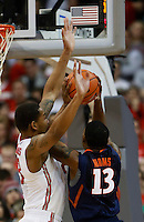Ohio State Buckeyes center Amir Williams (23) blocks Illinois Fighting Illini guard Tracy Abrams (13) in the second half at Value City Arena in Columbus Jan. 23, 2013 (Dispatch photo by Eric Albrecht)