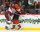 Devin Tringale (Harvard - 22), Ben Foster (Princeton - 22) - The Harvard University Crimson defeated the visiting Princeton University Tigers 5-0 on Harvard's senior night on Saturday, February 28, 2015, at Bright-Landry Hockey Center in Boston, Massachusetts.