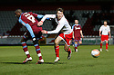 Luke Freeman of Stevenage (on loan from Arsenal) goes past Lucas Akins of Tranmere. - Stevenage v Tranmere Rovers - npower League 1 - Lamex Stadium, Stevenage - 17th December 2011  .© Kevin Coleman 2011 ... ....  ...  . .