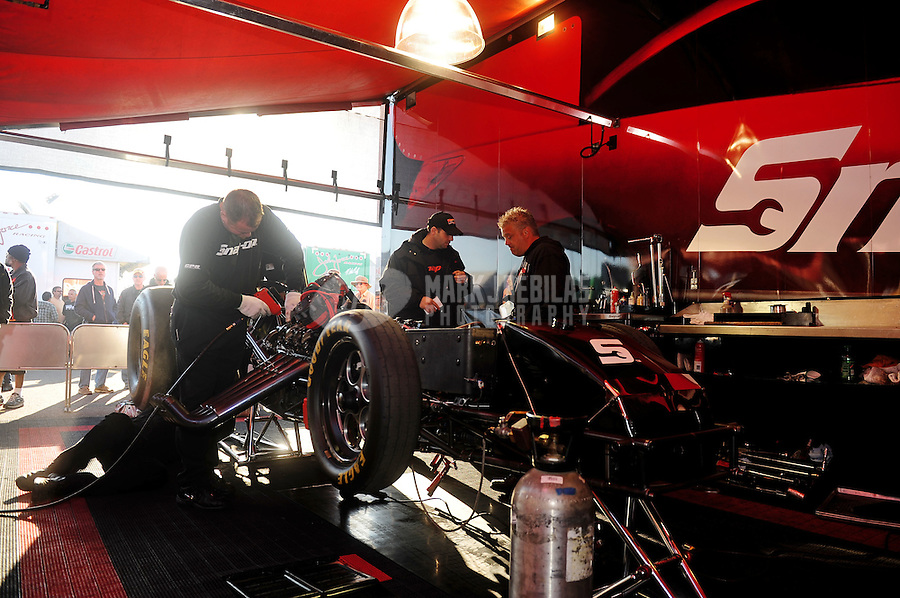 Mar. 13, 2011; Gainesville, FL, USA; Crew members work on the car of NHRA funny car driver Cruz Pedregon in the pits during the Gatornationals at Gainesville Raceway. Mandatory Credit: Mark J. Rebilas-
