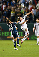 CARSON, CA - September 17, 2011: Vancouver Whitecaps forward Davide Chiumiento (20) and LA Galaxy midfielder Chris Birchall (8) during the match between LA Galaxy and Vancouver Whitecaps at the Home Depot Center in Carson, California. Final score LA Galaxy 3, Vancouver Whitecaps 0.