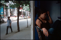 """Fengdu, China, August 2003.Very few inhabitants remain in the """"old"""" city of Fengdu, soon to be totally destroyed, among them, a significant number of prostitutes..."""