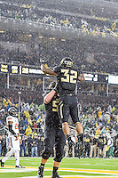 Baylor offensive tackle Spencer Drango (58) celebrates a touchdown scored by running back Shock Linwood (32) during second half of an NCAA football game, Saturday, November 22, 2014 in Waco, Tex. Baylor defeated Oklahoma State 49-28. (Mo Khursheed/TFV Media via AP Images)