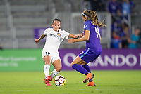 Orlando, FL - Saturday March 24, 2018: Utah Royals midfielder Taylor Lytle (12) plays the ball past Orlando Pride defender Shelina Zadorsky (4) during a regular season National Women's Soccer League (NWSL) match between the Orlando Pride and the Utah Royals FC at Orlando City Stadium. The game ended in a 1-1 draw.