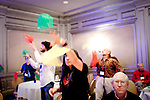 Hilarie Orman, of Utah, juggles scarves during a presentation by Laurie Young about doing new things to stay sharp at G4G9, the ninth Gathering for Gardner. G4G is a five-day conference for math and puzzle enthusiasts in honor of Martin Gardner Atlanta, Georgia, March 28, 2010