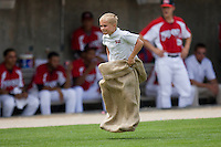 A young fan competes in a sack race between innings of a Southern League baseball game at Five County Stadium May 16, 2010, in Zebulon, North Carolina.  Photo by Brian Westerholt /  Seam Images