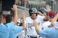 NWA Democrat-Gazette/ANDY SHUPE<br /> Northwest Arkansas Naturals first baseman Alex Liddi watches Wednesday, July 11, 2018, celebrates with teammates after hitting a solo home run against the Tulsa Drillers to begin a seven-run inning fourth inning at Arvest Ballpark in Springdale. Visit nwadg.com/photos to see more photographs from the game.