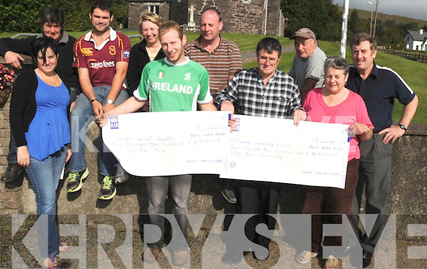 HELPING OTHERS: Pictured at Bonane Community Council as they presented cheques worth ?9,900 in aid of Irish Cancer Society and Bonane Community Council, as a result of the sheep sheering record in Bonane recently. Front l-r: Irene Carey, Denis O'Sullivan, Steven O'Sullivan and Dolly O'Reilly. Back l-r: Breda and PJ Lynch,  Patricia O'Sullivan, Martin O'Reilly, Pasty O'Sullivan and Danny O'Connor.