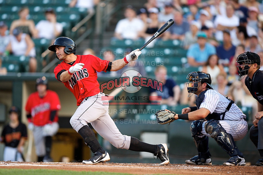 Indianapolis Indians shortstop Chase d'Arnaud #2 bats in front of catcher Francisco Cervelli and umpire Jeff Gosney during a game against the Empire State Yankees at Frontier Field on August 4, 2012 in Rochester, New York.  Empire State defeated Indianapolis 9-8 in ten innings.  (Mike Janes/Four Seam Images)