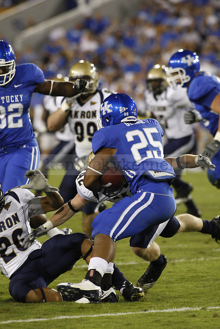 Tail Back Jonathon George evades Akron defenders during the second half of UK's home game against Akron. UK won 47-10. Saturday, September 17, 2010.  Photo by Brandon Goodwin | Staff