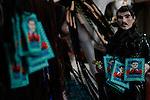 Altar en honor a Jesús Malverde Jesús Malverde que es venerado como Santo el cual todos los días  atrae a cientos de seguidores a su capilla en la capital de Sinaloa, tierra de los principales narcotraficantes mexicanos.....Existen varias versiones de su  leyenda una de ellas cuenta que vivió hace más de un siglo en el norte de México robando a ricos para dar a los pobres, es ahora un jugoso negocio para los presos en las cárceles de Mexico en donde se  fabrican  una diversidad de artículos  de este santo venerado por el narcotráfico mexicano...Malverde no es reconocido por la Iglesia Católica como un santo que hace milagros.....Culiacan Sinaloa Mexico, Enero 2013..**(Baldemar de los Llanos/NortePhoto)**
