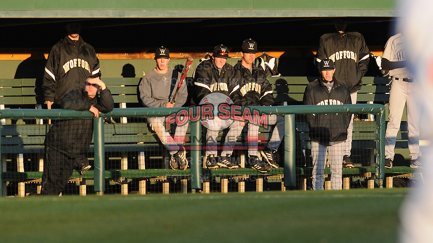 Wofford Terriers players try to shield their eyes from the sun late in the afternoon in a game against the Clemson Tigers on Wednesday, March 6, 2013, at Doug Kingsmore Stadium in Clemson, South Carolina. Clemson won, 9-2. (Tom Priddy/Four Seam Images)