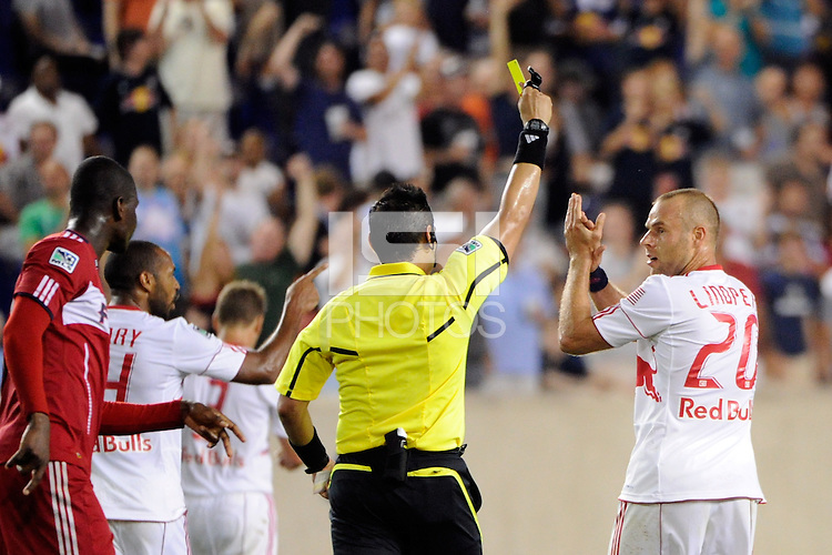 Joel Lindpere (20) of the New York Red Bulls applauds getting booked by referee Jair Marrufo. The New York Red Bulls and the Chicago Fire played to a 2-2 tie during a Major League Soccer (MLS) match at Red Bull Arena in Harrison, NJ, on August 13, 2011.