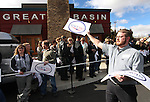 Volunteer Tom Parker hands out signs to supporters waiting for Republican presidential candidate Newt Gingrich before a campaign stop at the Great Basin Brewing Company in Reno, Nev., on Wednesday, Feb. 1, 2012..Photo by Cathleen Allison
