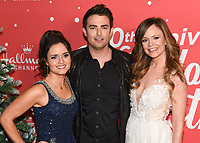 "20 November 2019 - Hollywood, California - Danica McKellar, Jonathan Bennett, Rachel Boston. Hallmark Channel's 10th Anniversary Countdown to Christmas - ""Christmas Under the Stars"" Screening and Party. Photo Credit: Billy Bennight/AdMedia"