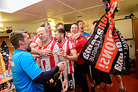 Lincoln City's goalkeeping coach Jimmy Walker sprays champagne as the Imps celebrate in the changing room after the game<br /> <br /> Photographer Chris Vaughan/CameraSport<br /> <br /> Vanarama National League - Lincoln City v Macclesfield Town - Saturday 22nd April 2017 - Sincil Bank - Lincoln<br /> <br /> World Copyright &copy; 2017 CameraSport. All rights reserved. 43 Linden Ave. Countesthorpe. Leicester. England. LE8 5PG - Tel: +44 (0) 116 277 4147 - admin@camerasport.com - www.camerasport.com