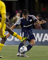 Under pressure, New England Revolution defender Franco Coria (2) passes the ball.  In a Major League Soccer (MLS) match, the Columbus Crew defeated the New England Revolution, 3-0, at Gillette Stadium on October 15, 2011.