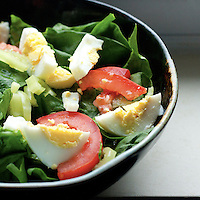 Spinach Salad With Egg, Tomato, Banana Peppers, and Pepper.