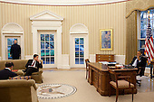 United States President Barack Obama talks on the phone while Vice President Joe Biden, his National Security Advisor Tony Blinken, and Puneet Talwar, Senior Director for Iraq, Iran and the Gulf States wait nearby in the Oval Office, November 4, 2010.  .Mandatory Credit: Pete Souza - White House via CNP