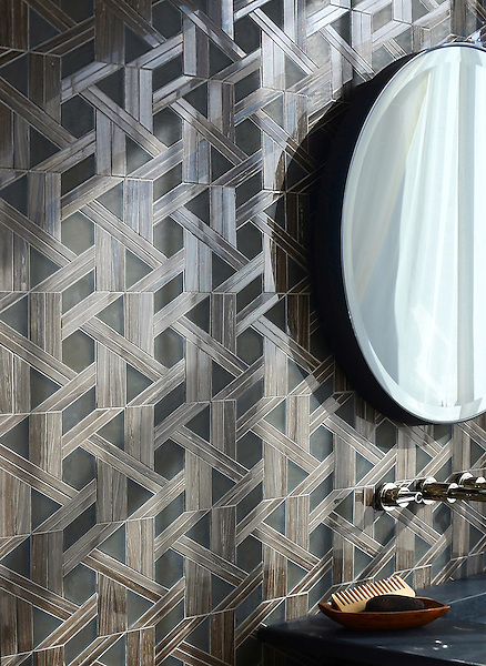 Hector, a stone waterjet mosaic, shown in Bayard polished and Burnt Umber glass honed, is part of the Altimetry® Collection for New Ravenna.