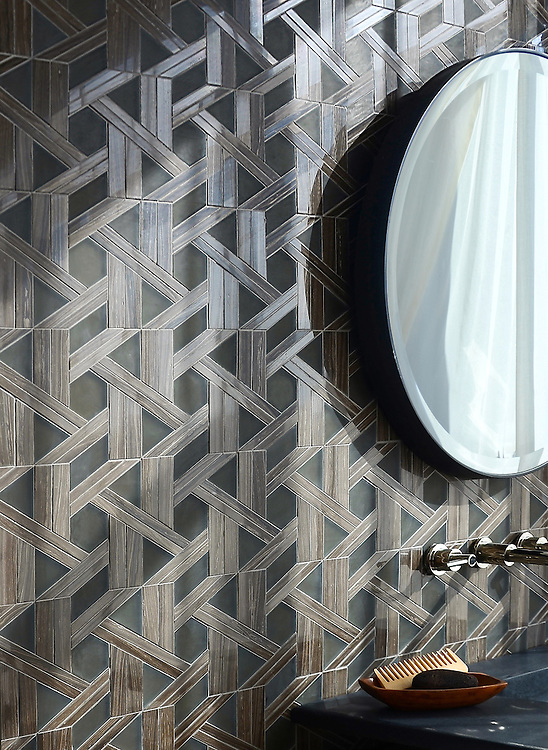 Hector, a stone waterjet mosaic, shown in polished Bayard and matte Burnt Umber Serenity glass, is part of the Altimetry® collection for New Ravenna.