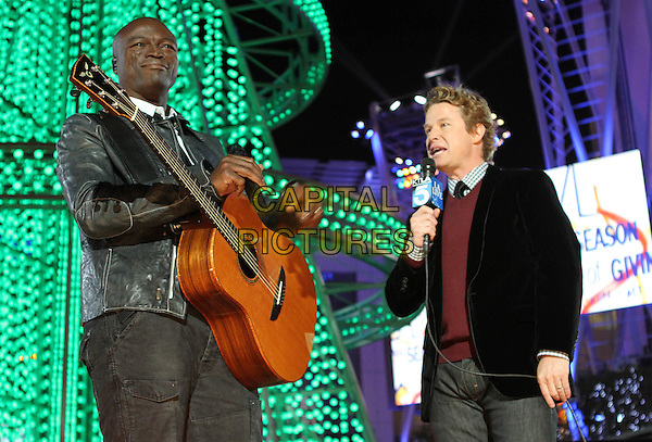 SEAL .The Holiday Tree Lighting At L.A. Live & Opening Of L.A. Kings Holiday Ice held At L.A Live,  Los Angeles, CA, USA, .4th December 2010..music concert gig live on stage half length  guitar  black leather jacket tie white shirt  .CAP/ADM/KB.©Kevan Brooks/AdMedia/Capital Pictures.