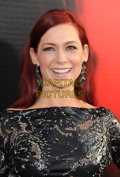 Carrie Preston<br /> &quot;True Blood&quot; Season 6 Los Angeles Premiere held at The Cinerama Dome, Hollywood, California, USA.<br /> June 11th, 2013 <br /> headshot portrait black dangling green earrings leather cut out qaway<br /> CAP/RKE/DVS<br /> &copy;DVS/RockinExposures/Capital Pictures