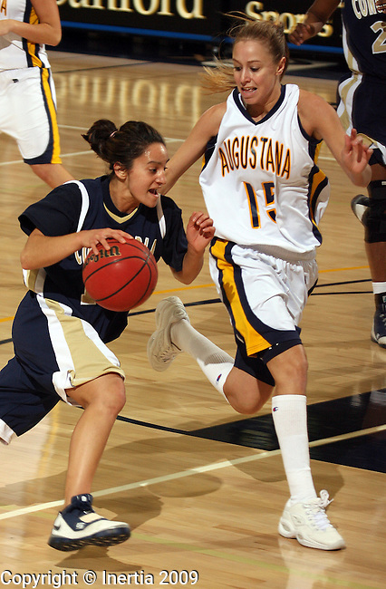 SIOUX FALLS, SD - JANUARY 29:  Jamie Jones #13 of Concordia University drives past Tessa Wilka #15 of Augustana in the first half of their game Friday night at the Elmen Center. (Photo by Dave Eggen/Inertia)