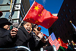 New York, United States. 17th February 2013 -- A Chinese girl screams as residents take part of the lunar new year of the snake during celebrations of the Chinese new year in New York. Photo by Eduardo Munoz Alvarez / VIEWpress.