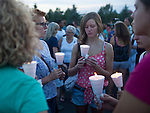 People attend a candle light vigil near the Century 16 movie theater where a gunman opened fire and killed 12 people the day before during opening screening of Batman The Dark Knight Rises in Aurora, Colorado. ..Ben Sklar