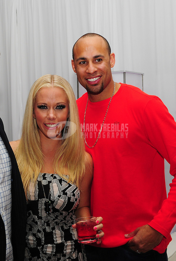 Feb 4, 2012; Indianapolis, IN, USA; Playboy playmate Kendra Wilkinson (left with husband Hank Baskett during the Leather and Laces event at the Regions Bank Tower. Mandatory Credit: Mark J. Rebilas-