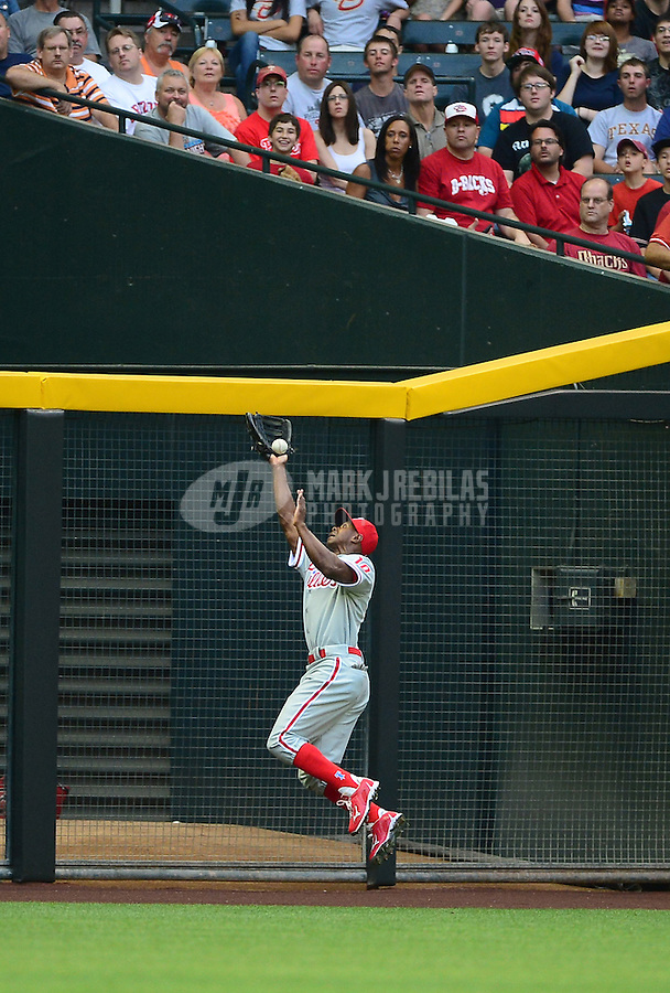 Apr. 23, 2012; Phoenix, AZ, USA; Philadelphia Phillies outfielder Juan Pierre fails to make a leaping catch in the first inning against the Arizona Diamondbacks at Chase Field. Mandatory Credit: Mark J. Rebilas-