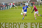 Bryan Sheehan for St Mary's with a little tap nudges the ball forward into the Dromid defence as he makes space from Dromid's Padraigh Ó Suilleabháin.