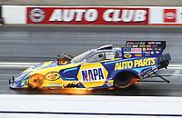 Feb 9, 2020; Pomona, CA, USA; NHRA funny car driver Ron Capps suffers an engine fire during the Winternationals at Auto Club Raceway at Pomona. Mandatory Credit: Mark J. Rebilas-USA TODAY Sports