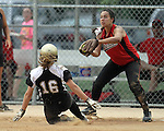 SIOUX FALLS, SD - JULY 7:  Maggie Dunnett #16 from the Minnesota Renegades is out at theirs on a force as Hannah Mandez #11 of the Shopokee Stealth catches the ball in the first inning of their 2013 Ringneck Softball tournament U16 Championship game Sunday evening at Sherman Park. (Photo by Dave Eggen/Inertia)