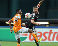 Washington D.C. - May 17, 2014: Perry Kitchen (23) of D.C. United heads the ball against Warren Creavalle (5) of Houston Dynamo.  D.C. United defeated  the Houston Dynamo 2-0 during a Major League Soccer match for the 2014 season at RFK Stadium.