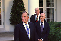 Washington DC., USA, 1990<br /> President George H.W. Bush talks with reporters in the Rose Garden as National Security Advisor Brent Scrowcroft  and press secretary Marlin Fitzwater look on. Credit: Mark Reinstein/MediaPunch
