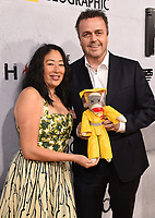 "BEVERLY HILLS - MAY 9: Composer Sean Callery and Debbie Dao attends the L.A. premiere of National Geographic's 3-Night Limited Series ""The Hot Zone"" at the Samuel Goldwyn Theater on May 9, 2019 in Beverly Hills, California. The Hot Zone premieres Monday, May 27, 9/8c. (Photo by Frank Micelotta/National Geographic/PictureGroup)"