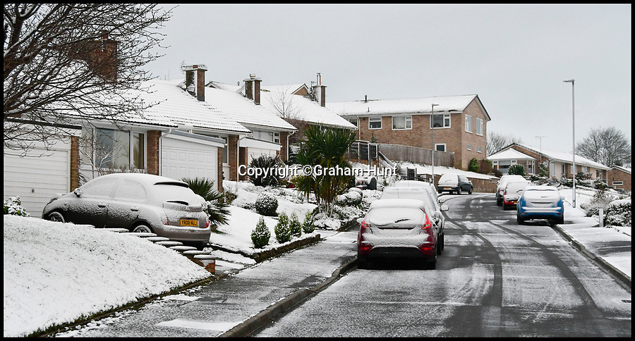 BNPS.co.uk (01202 558833)<br /> Pic: Graham Hunt/BNPS<br /> <br /> Houses and cars at Bridport in Dorset covered in snow after heavy overnight snow covers southern Britain.