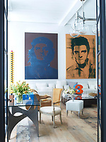 A pair of paintings by Gavin Turk hangs above an Axel Vervoordt sofa in the library; the 1970s suede chairs are by Klaus Uredat, a Robert Indiana sculpture sits atop a vintage French cocktail table, and the 1960s chandelier is Austrian; a 1966 table by Philippe Hiquily is paired with a Louis XVI fauteuil with its original upholstery; the painting is by Josef Albers. The Philippe Starck chairs in the library were prototypes for the Royalton Hotel. The 18th-century floorboards were salvaged from a Pennsylvania farmhouse.