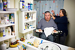 In Home Supportive Services (IHSS) caregiver Teresita Perez de Godoy, right, combs the hair of quadriplegic Francisco Godoy in his Sacramento, CA home January 22, 2010. Francisco needs around-the-clock care from Teresita, his ex-wife who also lives with him. The state pays Teresita for 283 hours per month, at $10.40/hour. Gov. Schwarzenegger has proposed cutting or eliminating the IHSS program which provides care for 450,000 Californians and jobs for 375,000 caregivers. If the program was eliminated, most would need to be institutionalized, likely at far greater taxpayer expense. CREDIT: Max Whittaker for The Wall Street Journal.CABUDGET